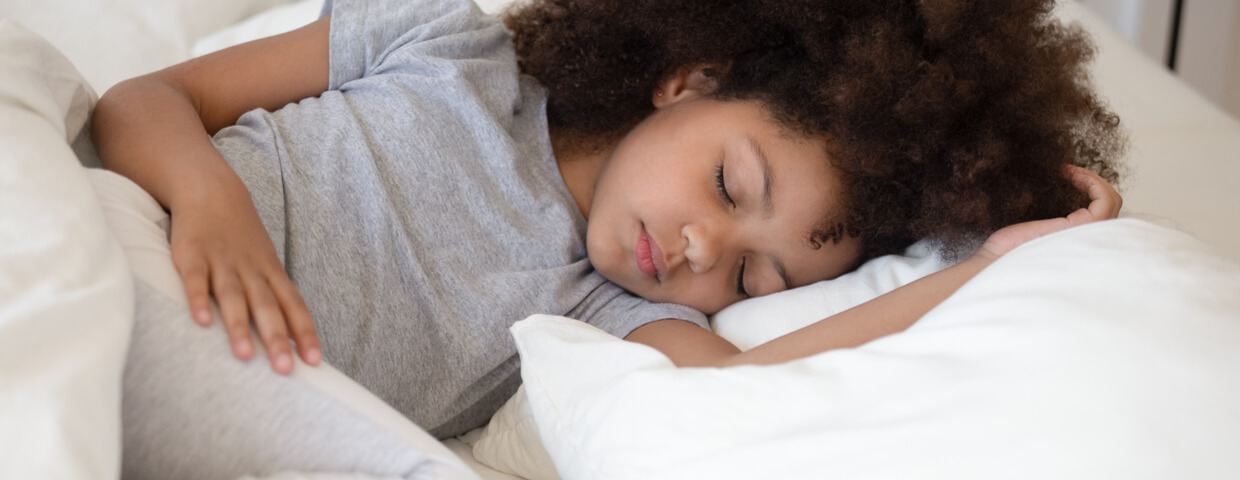 6 years old adorable girl closed eyes lying in bed sleeping on white bed, child sleeping, healthy sleeping habits, sleep for children