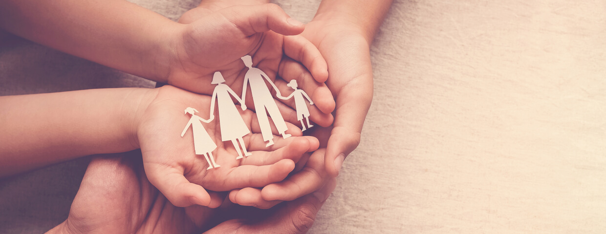 hands holding paper family cutout, family home, family volunteering, as a family concept