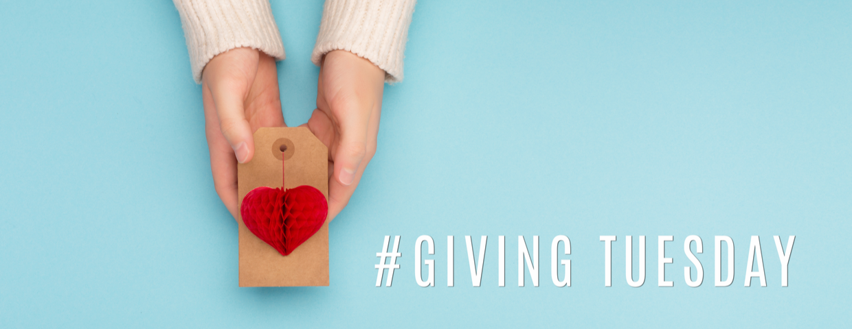 Hands holding a card with a heart, gift tag for donation concept, with the hashtag of Giving Tuesday or #GivingTuesday in the image