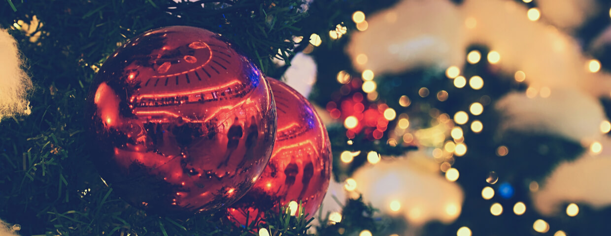 Holiday traditions concept, shiny red ornaments on Christmas tree